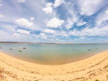 Praia De Faro, Algarve, Portugal. Aerial view on coast of ocean and beach. Boats on water, drone view royalty free stock image