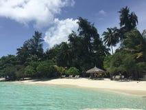 Praia de Kurumba nas ilhas de Maldivas Imagens de Stock