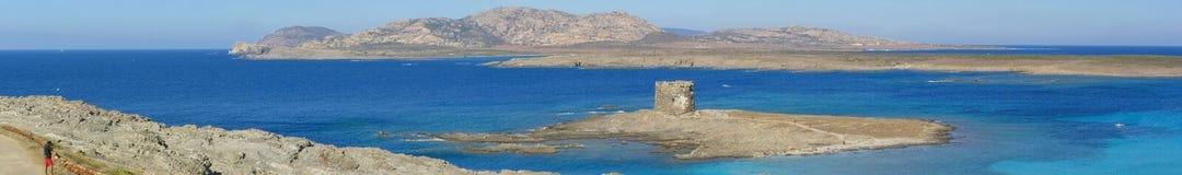 Praia de Pelosa do La em Sardinia, Italy - panorama Foto de Stock Royalty Free