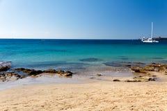 Praia de Playa Papagayo, Lanzarote, Spain, ti do verão Imagens de Stock