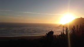 Praia de Ronca do por do sol imagens de stock