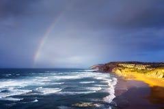 Praia de Sopelana com nuvens tormentosos e arco-íris Fotos de Stock Royalty Free