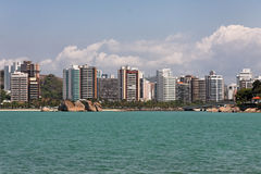 Praia do Canto Vitoria. The buildings, the rocks, the sand and the green water of the Atlantic Ocean in Praia do Canto, Vitoria, Espirito Santo state, Brazil Royalty Free Stock Images