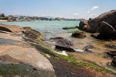 Praia do Canto Vitoria. The buildings, the rocks, the sand and the green water of the Atlantic Ocean in Praia do Canto, Vitoria, Espirito Santo state, Brazil Stock Image