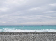 A praia do cascalho da areia Imagens de Stock