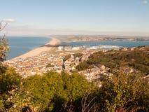 praia do chesil da ilha do lan do verão de Inglaterra da opinião da praia de portland fotos de stock