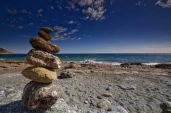 Praia do espanhol da estátua do seixo Imagens de Stock