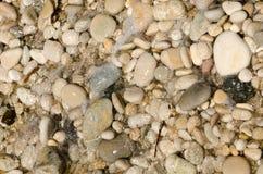 A praia do fim de semana da Espanha textures as pedras 3 do fundo foto de stock