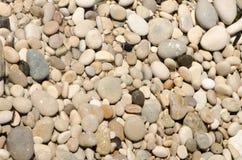 A praia do fim de semana da Espanha textures as pedras 2 do fundo Fotografia de Stock