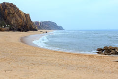 Praia do Guincho Santa Cruz, Portugal. Sandy beach Praia do Guincho Santa Cruz, Portugal. Misty weather Royalty Free Stock Images