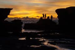 Praia do lote de Tanah no por do sol Fotografia de Stock