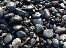 A praia do oceano apedreja o fundo Imagem de Stock