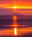 Praia e céu do por do sol Fotografia de Stock Royalty Free