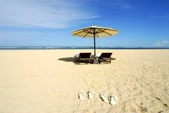 praia e cadeira Foto de Stock