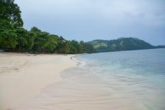 Praia e ele lugar do ` s fotos de stock