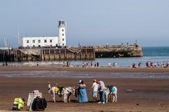 Praia e farol no verão Imagens de Stock