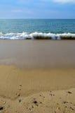 Praia e maré Foto de Stock