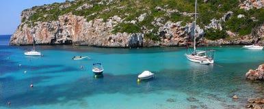 Praia e oceano de Cala Canutells Imagem de Stock Royalty Free
