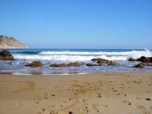 Praia e pegadas fotografia de stock