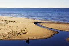 A praia e a senão Imagem de Stock