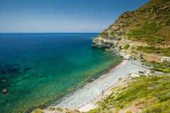 Praia e torre Genoese em Negru em Cap Corse Imagem de Stock Royalty Free