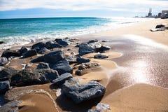 Praia ensolarada Fotos de Stock Royalty Free