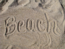 Praia escrita na areia Foto de Stock Royalty Free