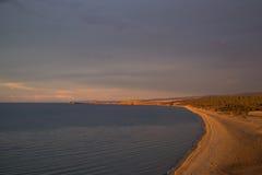 Praia gigante da areia sem povos Imagem de Stock