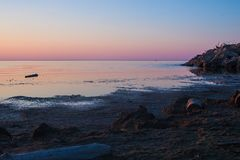 Praia no crepúsculo Fotografia de Stock Royalty Free