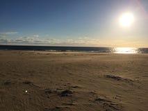 Praia no nascer do sol Foto de Stock