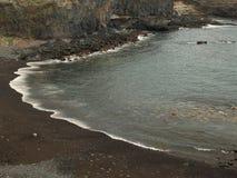 Praia preta da areia Imagem de Stock