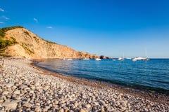 Praia seixoso de Ibiza Foto de Stock Royalty Free