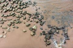 Praia suja Fotografia de Stock