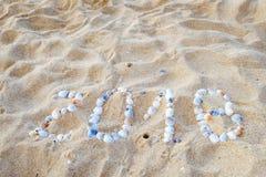 Praia tropical e 2018 anos novos felizes Foto de Stock Royalty Free