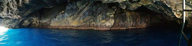 Praia uma égua - panorama da caverna azul fotografia de stock royalty free