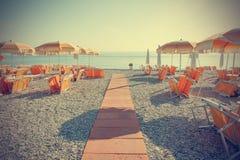 Praia vazia no vintage Fotos de Stock Royalty Free