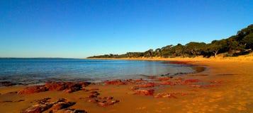 Praia vermelha da rocha Imagem de Stock Royalty Free