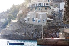 Praiano, Amalfi Coast, Italy, Europe - view of a house on the rocks mountains and a fishermen boat in the sea Royalty Free Stock Photos