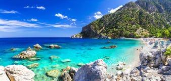 Praias bonitas de Grécia - Apella, Karpathos Fotografia de Stock
