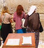 Praing women at the Wailing Wall. Royalty Free Stock Images