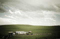Praires and cowboys 1. A scenic picture of the Alberta prairies with horses and horse trailer in a green setting Stock Images