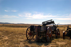 On the Prairie. Old wooden wagon abandoned on prairie stock photography