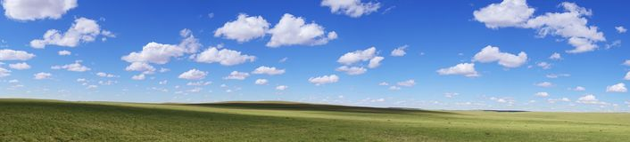 Clouds on the grasslands Stock Photos