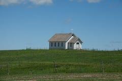 Prairie Church. An old prairie church on the horizon stock photo