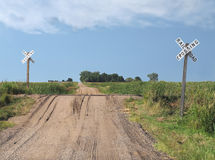 Prairie dirt road railroad crossing Royalty Free Stock Photography
