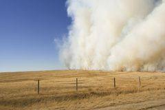 Prairie fire. Large grass fire in countryside stock photography