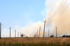 Prairie fire near the settlement Royalty Free Stock Photography