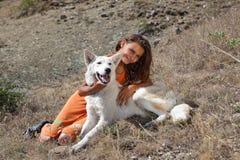 Prairie girl with dog stock photo