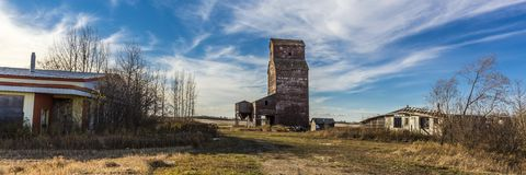 Prairie Grain Elevator. Grain elevators, which have been variously referred to as prairie icons, prairie cathedrals or prairie sentinels, are a visual symbol of Royalty Free Stock Images