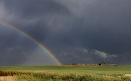 Prairie Hail Storm and Rainbow Royalty Free Stock Image